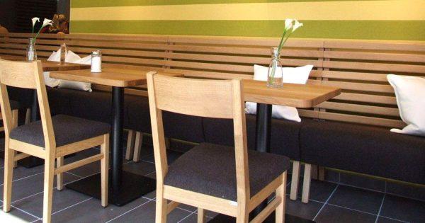 Kantinenbänke Stollenbank Säulentische Holzstühle Rückenlehne Buchenlatten Kantine